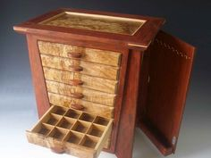 1000 Handmade exotic wood jewelry box made of bubinga wood and burl; with seven drawers and a door that has nine hooks for necklaces