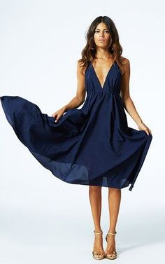 Perfect dress to wear as a wedding guest. Low neckline navy dress with flowing skirt. gold strappy heels. Sexy, but classy! #stitchfix #sponsored - ask your stylist to send you something like this for your next special occasion - cl