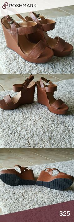"Brand NWOT brown vegan ""leather"" wedges Never worn and super cute for spring/summer! Vegan leather wedges approximately 4 inches tall. Black Poppy from Pacsun Black Poppy Shoes Wedges"