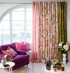 I like the different fabrics on the window... Quirky but elegant...