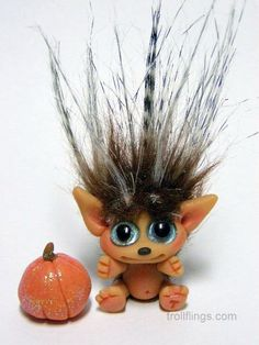 A sweet wide eyed Hedgehog girl with a tiny glittered pumpkin, this is Ginnie!    Ginnie is super small, one inch high from her bottom to the tip of