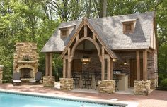 pool house with fireplace and bar | Pinterest / Love this pool house with outdoor kitchen, fireplace, and ...