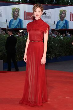 Alba Rohrwacher Evening Dress - Alba Rohrwacher was pure elegance at the Venice Film Fest premiere of 'Blood of My Blood' in a high-neck red Valentino Couture gown with a pleated yoke overlay.