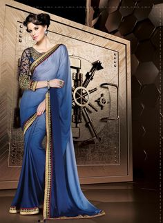 Vogue and trend could be on the peak of your elegance the moment you attire this blue faux crepe designer saree. The embroidered and patch border work appears to be chic and best for any affair. Comes...