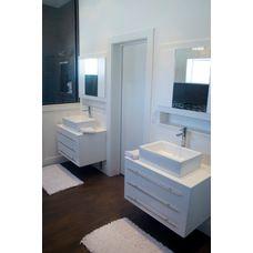 Modern Contemporary Home. Master bathroom, rectangle vessel dual sinks, flush frameless cabinets, glass walled shower.