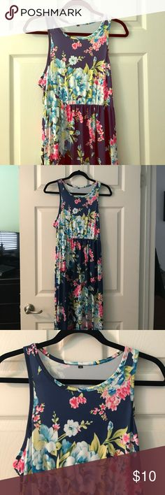 Floral Maxi Dress Dark blue with light blue, pink, and green floral print. So cute! Features pockets and slight racer back. Worn once. Dresses Maxi