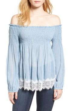 smocked off the shoulder top by Willow & Clay. Trimmed with delicate eyelash lace, this shoulder-flaunting smocked top is all boho-inspired romance with its swingy,...