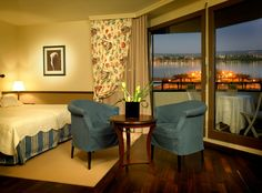 Another room of the Romantik Hotel Mont-Blanc au Lac with a panoramic view of the Lake Genevia in Morges (Switzerland) Valance Curtains, Hotel Mont Blanc, Decor, Curtains, Hotel, Views, Home Decor, Room, Panoramic Views