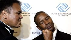 Muhammad Ali landed an uppercut on Denzel Washington as they attended the Boys & Girls Clubs of America President's Dinner, honoring the actor, at the Waldorf Astoria in New York City on June 9, 2004.