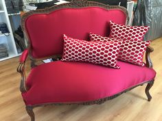 Love seat in red satin