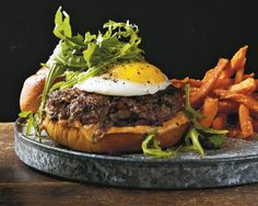 Mushroom Burgers with Fried Egg and Truffle Oil Recipe by Crave Cooking Light Cookbook - The Daily Meal Burger Recipes, Egg Recipes, Cooking Recipes, Yummy Recipes, Burger Ideas, Cooking Stuff, Light Recipes, Amazing Burger, Good Burger