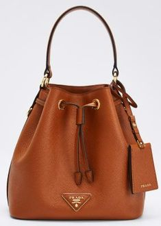 Saffiano Bucket Bag w/ Removable Crossbody Strap #pradahandbagsvintage #pradahandbagssmall #pradahandbagsbrown #pradahandbagsleather #pradahandbagstaylorswift #pradahandbagscrossbody Prada Bag, Prada Handbags, Black Handbags, Fashion Handbags, Women's Crossbody Purse, Leather Crossbody, Small Shoulder Bag, Chain Shoulder Bag, Prada Messenger Bag