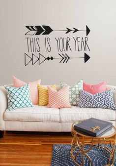 Creative throw pillows and statement wall piece. #HomeDecor #Redecorate #ACreativeCulture