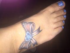Diamond bow tatt by :  Hector K from chi-city