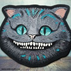 """Size of large patch Cheshire Cat is 10.8"""" x 9""""   27.4 cm x 23 cm.    BACKING:  Iron on - You can apply this patch to your garment using a hot iron, instructions are included in the package. Sew on - You can also hand sew or machine sew it on your garment.     FABRIC: Gabardine.    THREAD: Viscose.    PERFECT FOR: t-shirts, polo shirts, jackets, backpacks, bags, jeans etc.    SHIPPING: Air mail - free (10-15 days).   Shop this product here: spreesy.com/EmbroSoft/233   Shop all of our products…"""