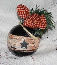 crackle primitive black star Christmas ornament ~  painted black then an overlay was painted through the center and a layer of crackle was added to give it a country look. A black star was been added to one side.
