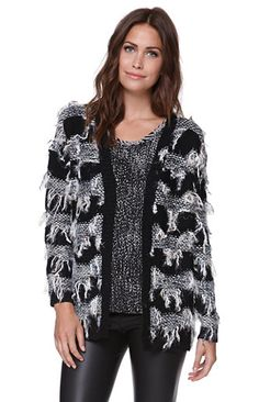 The women's Fringe Striped Cardigan by Lush features a striped fringe look and super cozy fabric. The cardigan has an open front and long sleeves.