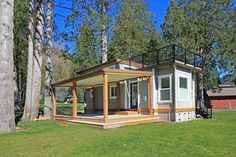 TINY HOUSE TOWN: The Bellevue At Wildwood Lakefront Cottage-The Bellevue, a luxury property at the Wildwood Lakefront Resort on Lake Whatcom in Washington. The home comes fully furnished and with two decks.