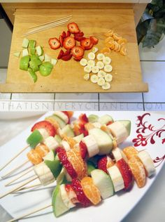 For the wedding in our colors (purple, orange, green)!  Green apple slices, orange slices, grapes, mango and kiwi!