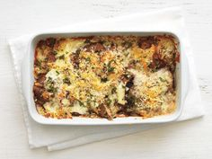 Portobello Gratin : Muenster cheese is layered with portobello mushrooms in this hearty gratin finished off with breadcrumbs for a crispy crust.