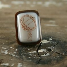 Atlas Shrugged Fused Glass Lapel Pin