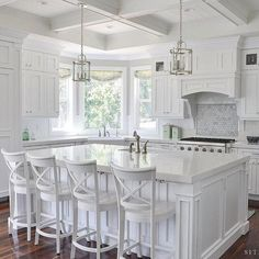 Kitchen layout is pretty with the extra big window