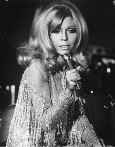 Above Photo: Nancy Sinatra. Nancy Sinatra's These Boots Are Made for Walkin' was released in February 1966 and quickly shot to Number 1 in the US, the UK and many other countries around the world. Nancy Sinatra, Divas, New Wave Music, Thing 1, Sexy Poses, Famous Women, Famous People, Female Singers, Big Hair