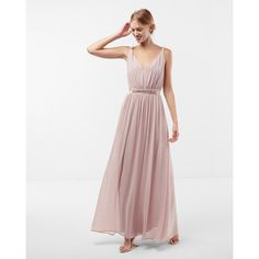 A graceful, flowing shape, glittering sash tie and softly twisted straps make this enchanting maxi dress an elegant choice for weddings, parties and more. Fin…