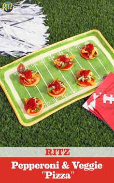 """Put your own twist on a game day staple with RITZ Pepperoni & Veggie """"Pizza"""" Bites. Top RITZ Crackers with pepperoni, cooked peppers and onions, shredded mozzarella cheese and a drizzle of pizza sauce. Victory is yours!"""