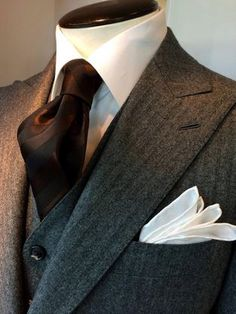 Dormeuil - A rich chocolate hue tie adds a dash of evening savoir faire to a flannel charcoal herringbone suit