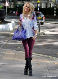 Cute casual outfit. I like how it pulls together girly with the floral shirt and purple purse and rocker chic with black studded boots. Add the colored jeans trend and done!