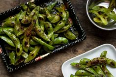 Easy and quick to make charred Edamame recipe loaded with natural umami and tossed with a garlicky lemon butter. Fantastic as a quick and flavorful snack and great with a cold glass of beer.