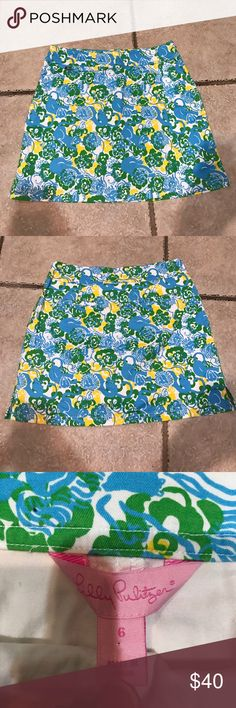 Lilly Pulitzer skirt Lilly Pulitzer skirt. Has white shorts underneath, great condition, zipper on the side, two pockets in the front and two on the back. Super cute design. Blue, yellow, green, and white. Size 6 Lilly Pulitzer Skirts