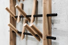 Coat Frame consists of three adjustable coat hangers, which are mounting in a frame made of bamboo.