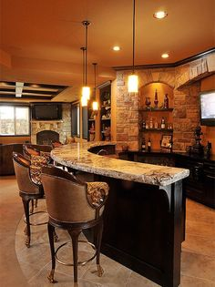 Exquisite #home #bar #design built for entertaining. Love the elegant chairs! Check more at www.oklahomahomes.com