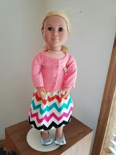 Fit a baby cardigan to doll and leftover home decor fabric from my friend who makes curtains