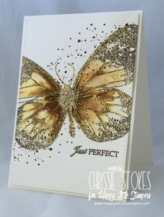 Butterfly sparkles. I couldn't find this on her blog, but it looks like she's used a large stamped butterfly, the, added distress inks and gilded flakes.