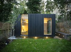 Garden room by Neil Dusheiko features walls of charred cedar — Dezeen - - Charred cedar clads the exterior of this garden room that architect Neil Dusheiko designed as an office-cum-yoga studio for a north London residence. Outdoor Office, Backyard Office, Backyard Studio, Modern Backyard, Shed Office, Office Kit, Office Pods, Garden Pods, Garden Cabins