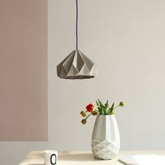 This lampshade has a cornered outside and a curved inside. with grey/white cord   The curved inside is quite unexpected. Just like the first time you open a c