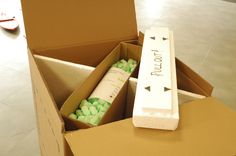 """Quantun Box: Inside are """"LOST"""" packaging information. The white 5cm+ solid foam lid is then placed in and over to seal the box and provide support to the internal structure."""