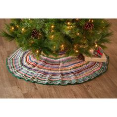 """Each hand-knit holiday tree skirt is made of colorful wool yarn remnants by artisans in Nepal, who pattern each in unique designs. No two pieces are alike! Colors will vary. Hand wash cold, dry flat. Dimensions: 45""""dia. Holiday Tree, Holiday Gifts, Holiday Decor, Green Gifts, Wool Yarn, Tree Skirts, Nepal, House Warming, Hand Knitting"""