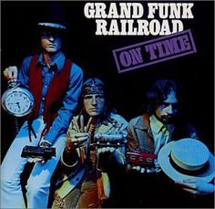 """Grand Funk Railroad - On Time  Grand Funk Railroad, sometimes shortened as Grand Funk, is an American rock band that was highly popular during the 1970s, touring extensively and playing to packed arenas worldwide. David Fricke of Rolling Stone magazine once said, """"You cannot talk about rock in the 1970s without talking about Grand Funk Railroad!""""Known for their crowd-pleasing arena rock style, the band was well-regarded by audiences despite a relative lack of critical acclaim.16"""