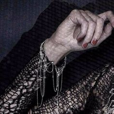 How I love a good detail. Hand cut yarn made from Swiss nylon mesh woven with real silver chain. Yes, it's a vegan dress and it's delicious. ••••••••••••••••••••••••••••••••••••• #detail #silver #rednails #vamp #deconstruction #knit #mesh #goth #vampire #blackwidow #handmodel