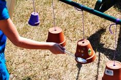 clay pots for musical wall.  These can sound great but they aren't as durable as most music station items; no problems, most children will be quite careful with them so long as you make sure they know that they can break if you hit them too hard. Repinned from Amy Ahola's Pinboard.