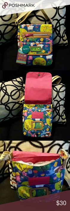 Lily Bloom varsity style padded tablet pocket Brand new, with tags, this is a beautiful Lily Bloom tablet pocket (or could be used just as a purse) its adorned with sheep, bunnys, flowers, birds and eggs. On front flap it has a zipper compartment with a lily bloom key chain on zipper also a snap open pouch. Flap opens up to reveal a bunch of different pockets for cards and a picture or id card. On the main inside pocket it has a back zipper compartment. On the back it also has a zipper…