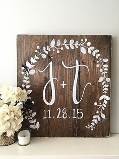This listing is for a hand painted wood sign which features the bride and grooms initials, as well as the wedding date. The background is a medium/dark stain with lightly distressed edges and white lettering. Size: 24 x 24 Want different color writing, different stain, or a