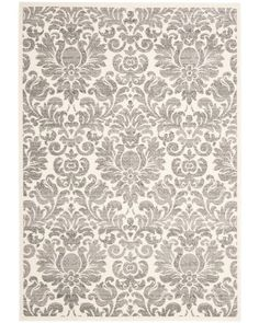 The damask print of this area rug gives it a classic look. The polypropylene pile means it's extra durable and easy to clean. One of our most-pinned products.
