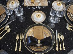 Stunning black and gold wedding table setting