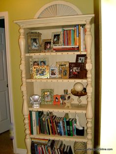 DIY Bookshelf Makeover using Recycled Spindles, Table Legs, Molding and Studs