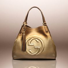 Bring a dose of brilliance to the everyday with the season's gilded Soho bag.